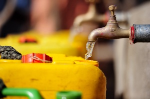 Water going into a jerry can at a charity: water project