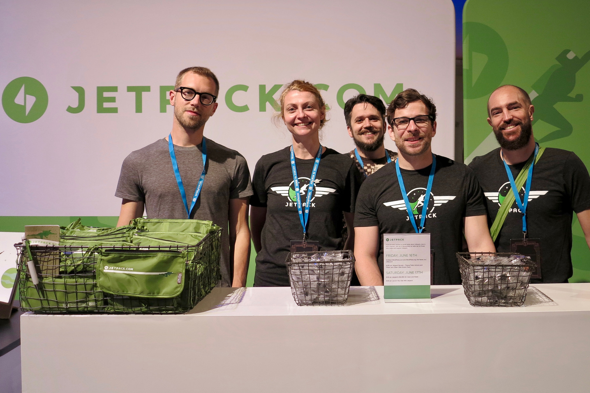Jetpack Sponsor Table at WordCamp Europe 2017. Photo by Oliver Gobet (https://www.flickr.com/photos/gd6d/)