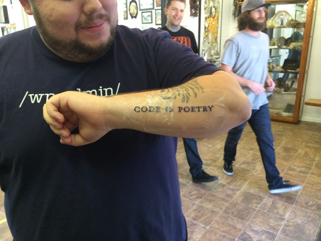 """code is poetry"" tattoo"