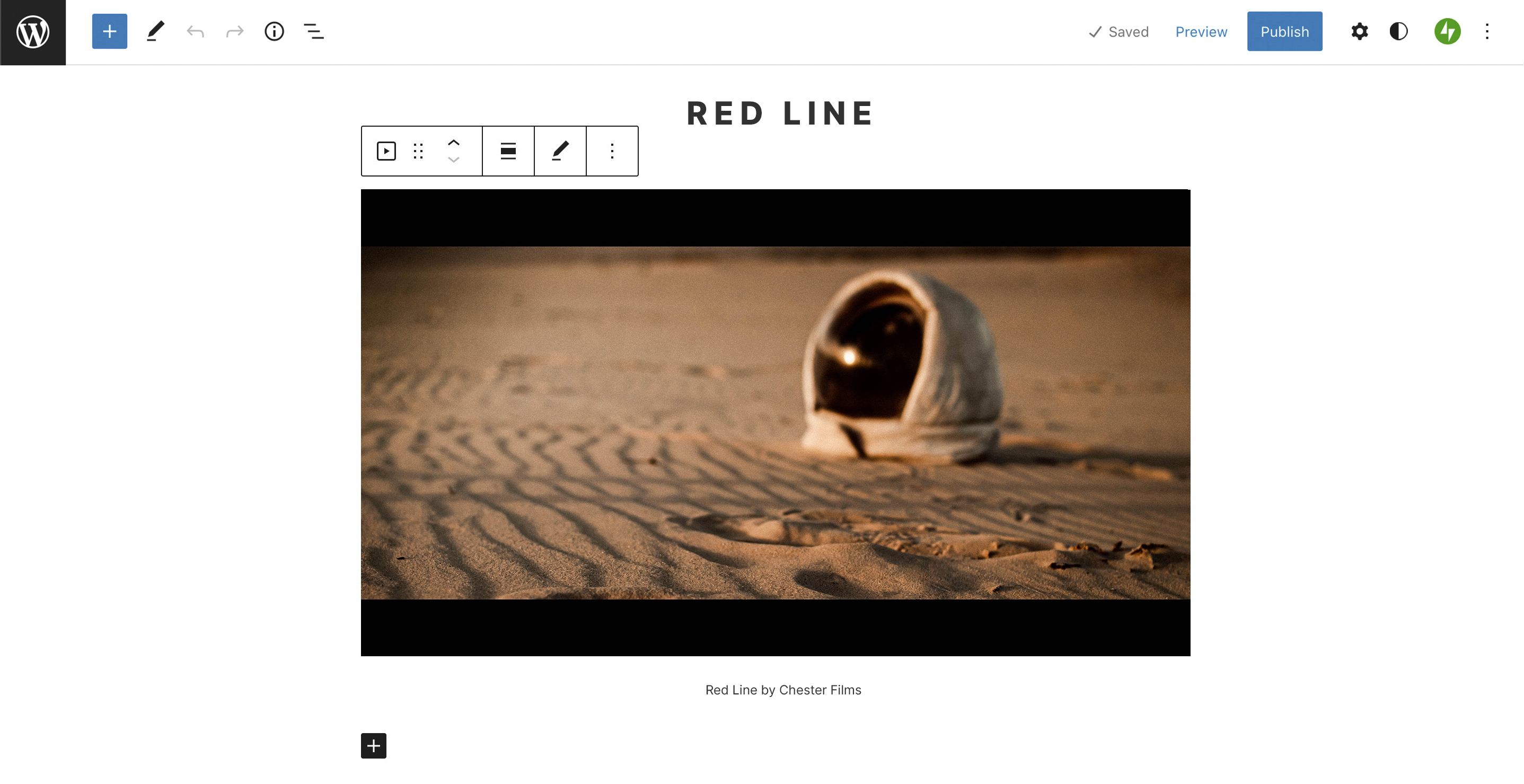 Screenshot of the WordPress editor with a video block included on the page. The video preview is of a space helmet on a different planet.
